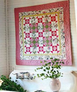 pink quilt and back porch tea pot plant